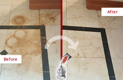 Before and After Picture of a Fair Grove Marble Floor Honed to Remove Rust Stains
